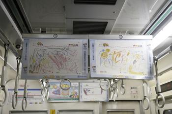 2011年12月29日 19時半頃、クハ6010車内、お子さんの作品が中吊り広告位置に掲出された車内。